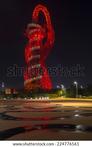 LONDON - October 11th 2014: Night view of the ArcelorMittal Orbit at the new Queen Elizabeth Olympic Park,  the symbolic legacy of the games designed by Sir Anish Kapoor and Cecil Balmond in London - stock photo