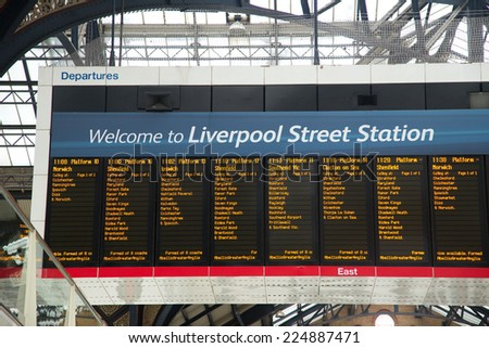 LONDON - OCTOBER 18TH: The timetable board at Liverpool street station on October 18th, 2014 in London, england, uk. Liverpool street is the busiest commuter station in London. - stock photo
