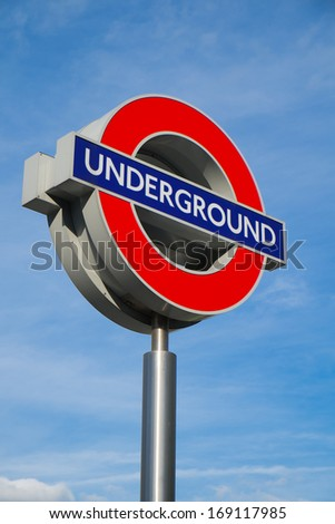 LONDON - OCTOBER 15: the Underground train logo at King's Cross station in London on October 15, 2013.  - stock photo