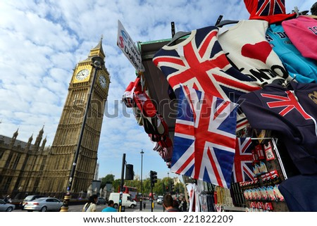 LONDON - OCTOBER 02: typical London street stall selling tourist souvenirs on October 02, 2014 in London, UK. London is one of the world's leading tourism destinations - stock photo