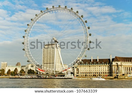 LONDON - OCTOBER16: View of London Eye,which is the tallest ferris wheel in Europe, along the bank of the Thames River on October16, 2011 in London. - stock photo