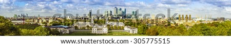 London panorama from Greenwich park, downtown, National Maritime Museum, skyscrapers of Canary Wharf and O2 arena - stock photo