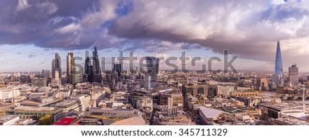 London panoramic skyline with dramatic clouds at sunset - London, UK - stock photo