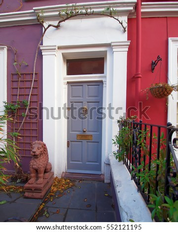 London, red and mauve vintage house front and lion statue