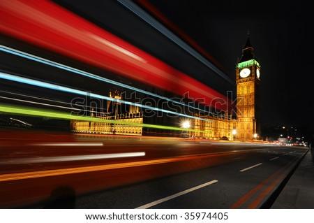 London Red Bus passing trough Big Ben - stock photo