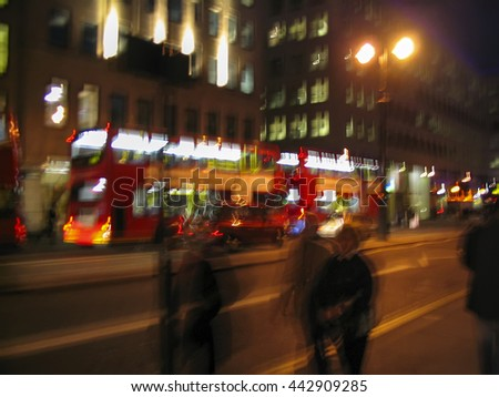 london red double decker bus public transport at night england united kingdom uk deliberate motion blur panned