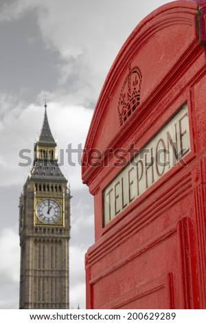 London Red Telephone Box with Big Ben on the background - stock photo