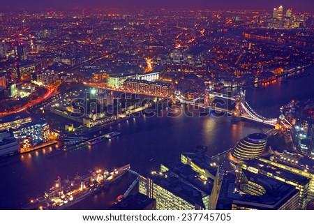 London rooftop view panorama at sunset with urban architectures and The Tower Bridge with Thames River at night - stock photo