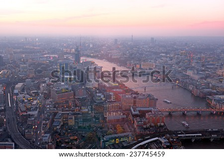 London rooftop view panorama at sunset with urban architectures  with Thames River at night - stock photo
