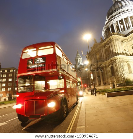 London Routemaster Bus and St Paul's Cathedral locates at the top of Ludgate Hill in the City of London   - stock photo