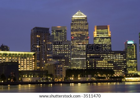 London's City Financial District - Canary Wharf at night - stock photo