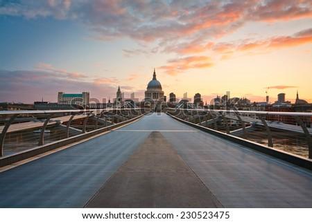 London's city skyline and the Millennium footbridge. - stock photo