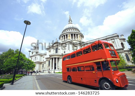 London's iconic Routemaster Bus and St Paul's Cathedral is in the background.   - stock photo