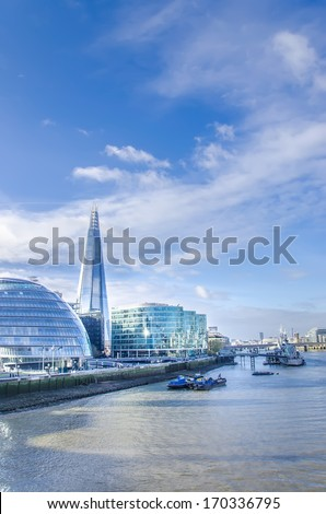 London's modern cityskape with tallest building The Shard and Town Hall on bright sky - Stock Image - stock photo