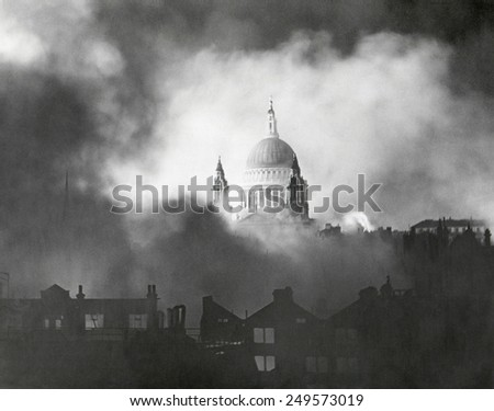 London's St. Paul's Cathedral during the great fire raid of Sunday, Dec. 29, 1940, during World War 2. - stock photo