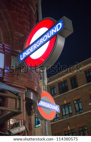 LONDON - SEP 27: Close up of two traditional station signs for the London Underground transportation systems on September 27, 2012 in London. The sign was first used in 1908 - stock photo