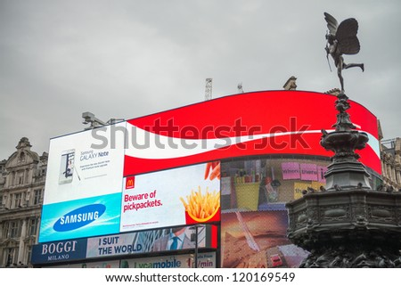 LONDON - SEP 27: Illuminated signs in Piccadilly Circus on September 27, 2012 in London. A major intersection in Central London is now a tourist attraction on its own right in London - stock photo