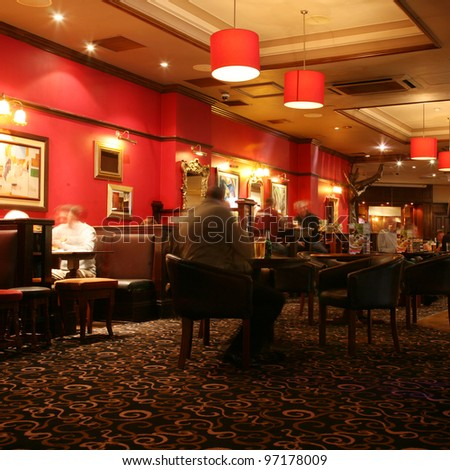 LONDON - SEP 06: Interior of pub, for drinking and socializing, focal point of the community, on Sep 06, 2010, London, UK. Pub business, now about 53,500 pubs in the UK, has been declining every year - stock photo