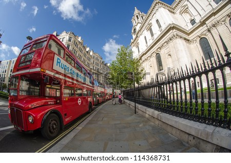 LONDON - SEP 29 : Red Double Decker Bus in the street of London on September 29, 2012 in London, UK. These buses are the most iconic symbol of London as well as Cabs and Taxis. - stock photo