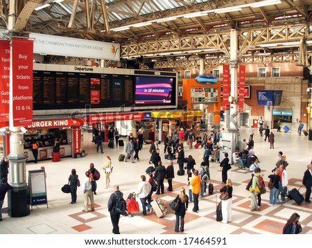 LONDON - SEPT 16: Passengers waiting for train arrivals at Victoria Station following severe delays due to a vehicle striking a bridge at Shortlands. September 16, 2008 - stock photo