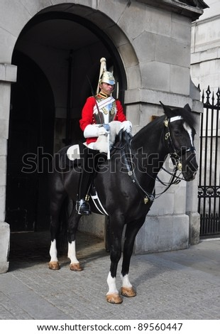 LONDON – SEPTEMBER 24: A cavalry trooper is posted outside the Horse Guards on September 24, 2011 in London, England. The Queens Cavalry was formed for 130 years ago. - stock photo