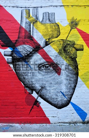 LONDON - SEPTEMBER 19, 2015. A wall painting in Hanbury Street  at Shoreditch in the Borough of Tower Hamlets, an area renown for its street art in east London, UK.