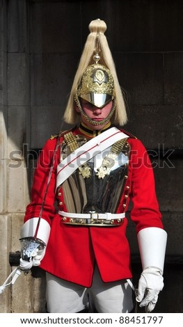 LONDON – SEPTEMBER 24: An unidentified Royal Cavalry is on guard at the Horse Guard Buildings on September 24, 2011 in London, England. The Queens Cavalry was formed more than 130 years ago. - stock photo
