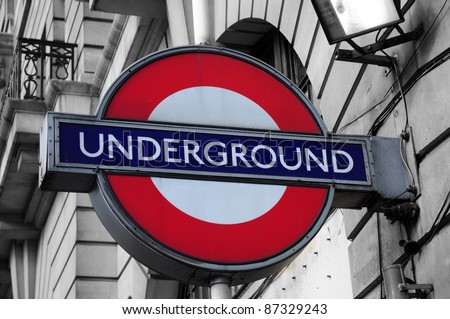 LONDON – SEPTEMBER 25: Close up of a traditional station sign for the London Underground transportation systems on September 25, 2011 in London. The sign was first used in 1908. - stock photo