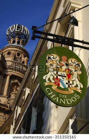 "LONDON - September 22 .2014: English pub sign ""the Chandos"". Public house, known as pub, is focal point of community, on London, UK.  - stock photo"