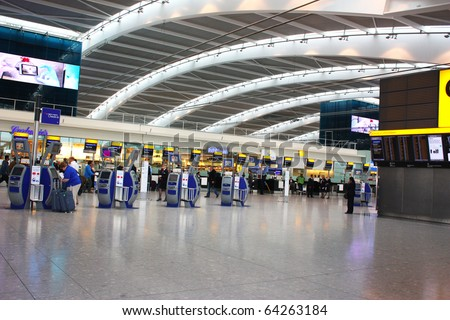 LONDON - SEPTEMBER 24 : Inside Heathrow Airport Terminal 5 Departure on September 24, 2010 in London, England. London Heathrow Airport is the largest airport in the United Kingdom. - stock photo