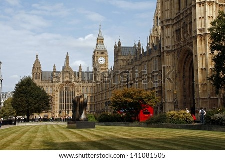 LONDON - SEPTEMBER 20 : Outside view of Westminister on Sept 20 , 2009 in London, England. It is the famous Houses of Parliament  in the capital city London. - stock photo