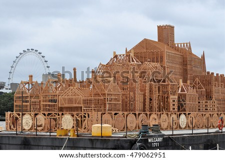 LONDON - SEPTEMBER 2, 2016. Part of the 400ft (122m) long timber sculpture by USA artist David Best floating on the River Thames ready to be set on fire to commemorate the 1666 Great Fire of London.