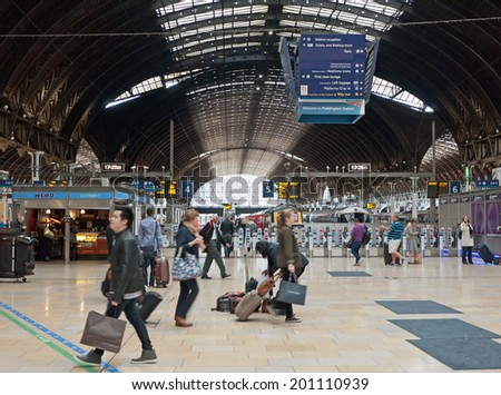 LONDON - September 14, 2013: Passengers in Paddington station. This central London railway station is terminus for Heathrow Express. - stock photo