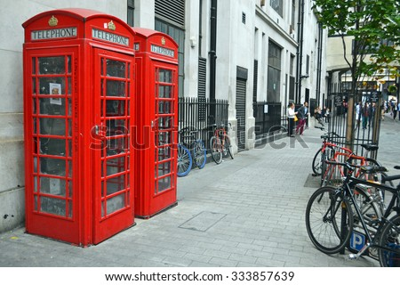London - September 13: Telephone boxes and bikes in London, UK on September 13, 2014. The traditional red British telephone box is seen as an iconic symbol around the world.