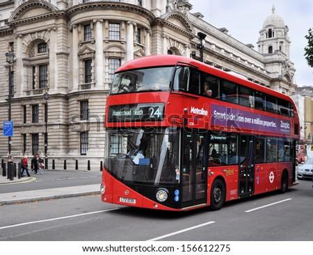 LONDON - SEPTEMBER 28. The new London Routemaster hybrid double deck bus with three doorways and two staircases accommodates 80 passengers; September 28, 2013, in Whitehall, London, UK.  - stock photo