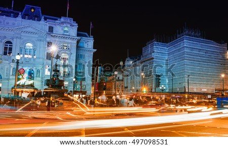 LONDON - SEPTEMBER 27, 2013: Tourists walk in Piccadilly area at night. The city is visited by more than 30 million people every year.