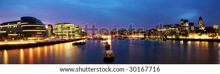 London skyline at twilight. (including City Hall, Gherkin, Tower 42, and HMS Belfast). - stock photo