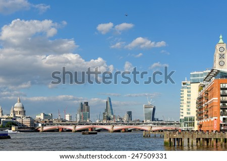 London skyline - Blackfriars bridge, St Paul Cathedral, The City and the Oxo Tower. - stock photo