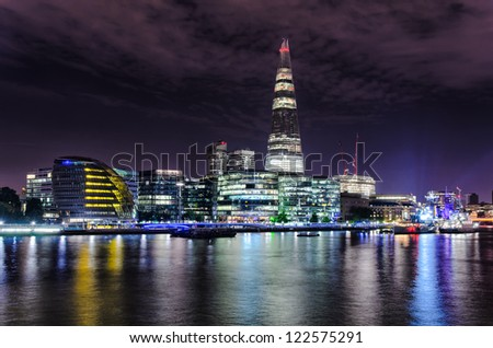 London skyline by night, including The Shard and the City Hall - stock photo