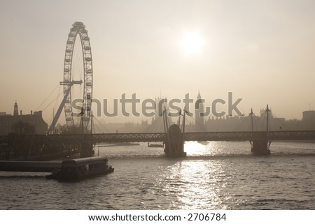 London skyline in the foggy day (London eye and Parliament) - stock photo