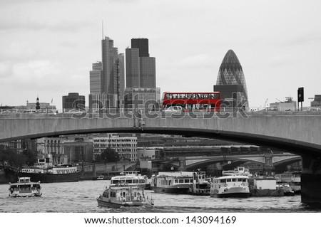 London skyline, include Waterloo Bridge, Red Double Decker Bus, seen from Victoria Embankment  - stock photo