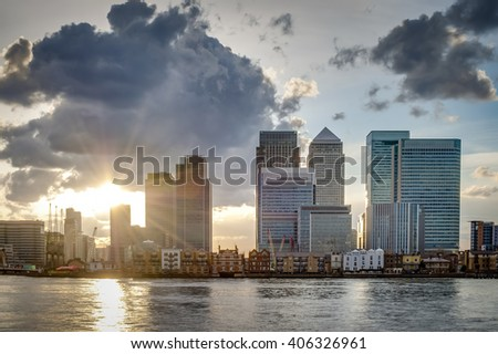 London skyline on a cloudy day at sunset seen from across the river Thames, Canary Wharf is Londonâ??s financial district a place where the worldâ??s greatest corporation and banks do business