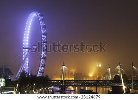 London skyline on a foggy night - stock photo