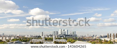 London Skyline seen from Greenwich Park. Overlooking Canary Wharf with Maritime Museum.   - stock photo