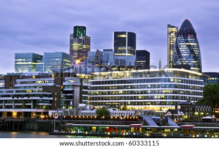 London skyline seen from the River Thames at twilight - stock photo
