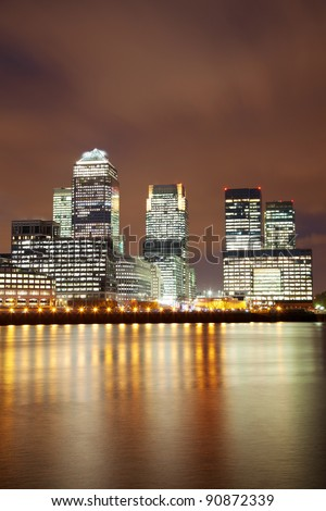 London skyscrapers and Thames in Docklands - stock photo