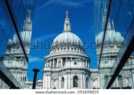 London. St Paul Cathedral reflected in modern glass on a beautiful summer day. - stock photo