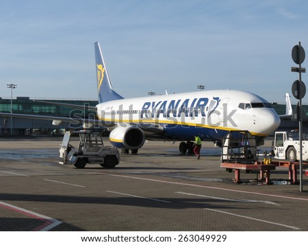 LONDON, STANSTED AIRPORT, UK - CIRCA JANUARY 2015:  Ryanair Jet aircraft preparing for boarding. Ryanair is the biggest low-cost airline company in the world.  - stock photo