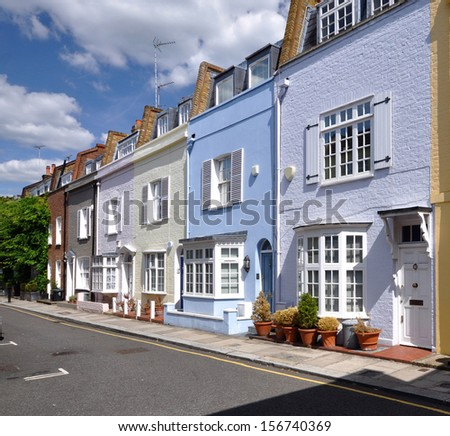 London street of colourful old terraced houses without parked cars.  - stock photo