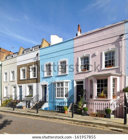 London street of colourful old terraced houses without parked cars - stock photo